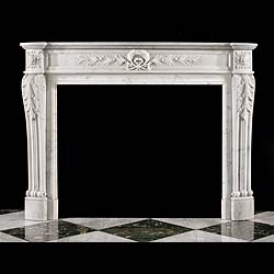 6565: Antique Louis XVI chimneypiece in statuary marble. The moulded shelf over a panelled frieze centred by a laurel wreath, and olive branches, signifying victory and peace, flanked by square floral pater