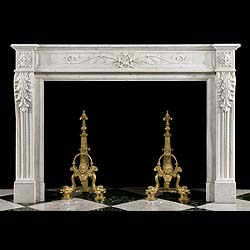 6573: A fine Louis XVI style chimneypece in Carrara Marble with a simple moulded shelf  above a panelled frieze centred by sprays of stylised olive branches signifying Victory and Peace. The endblocks, deco