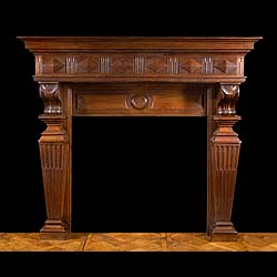 A large French carved Oak chimneypiece.