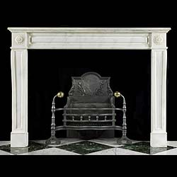 6583: A simple white statuary marble antique Louis XVI style fireplace. The paneled and beaded frieze is set between round floral paterae end blocks, below the rectangular moulded shelf. Supported on subtly