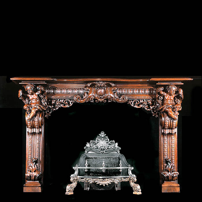 A Venetian Rococo Revival  style Regency walnut fireplace surround