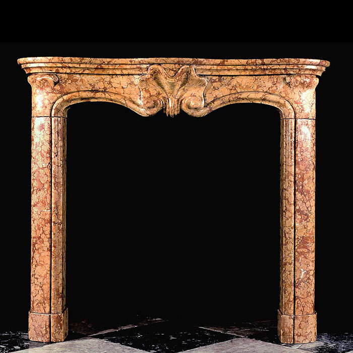 A Baroque style 20th century Rubbio Marble fireplace