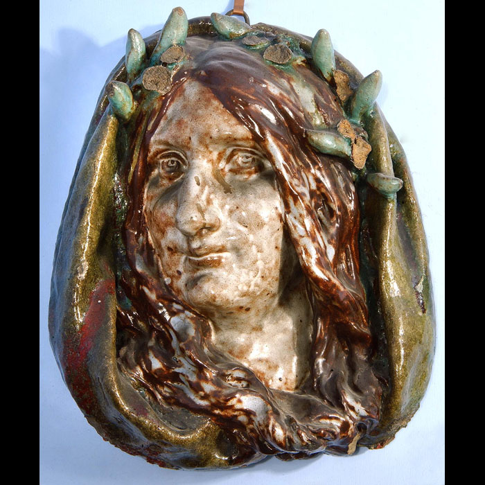 A French ceramic plaque of a woman