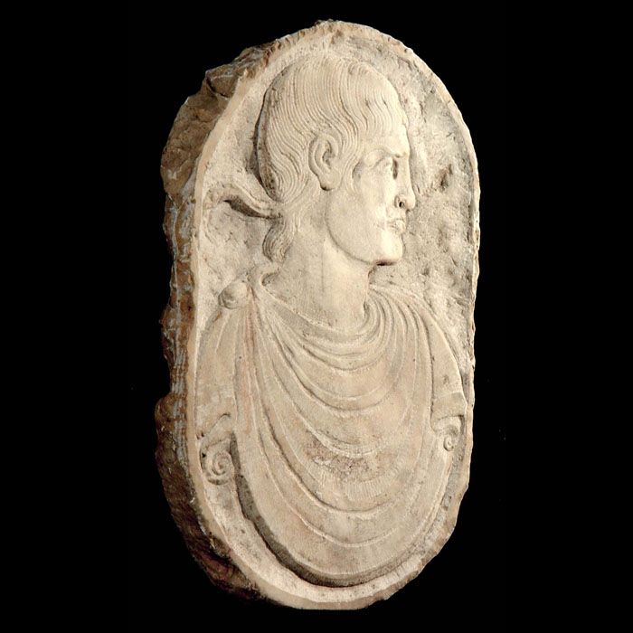 A small marble plaque of a Roman