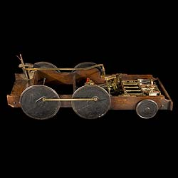 A Victorian Mahogany model of Steam Locomotive.