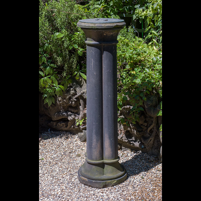 An antique bronze sundial mounted on a sandstone cluster column
