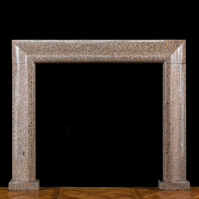 A 1930s pink granite Scottish Bolection Fireplace