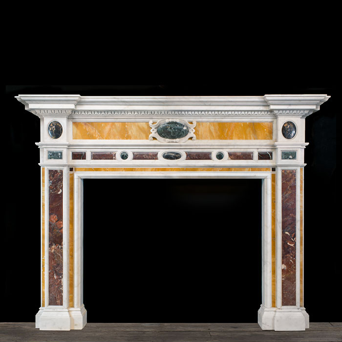 7360: A large and very finely made replica Chimneypiece in the Italian Neo Classical manner in Statuary Marble inlaid with Cippolino, Portoro, Sienna, Breccia Colorato and Aegean Bordeaux specimen marbles.