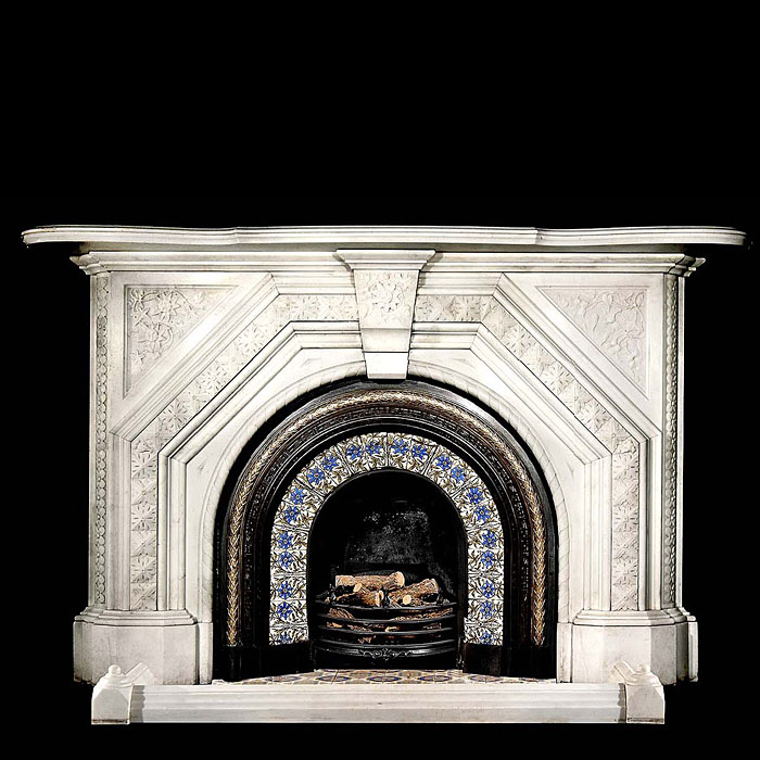 An arched statuary marble Victorian chimneypiece