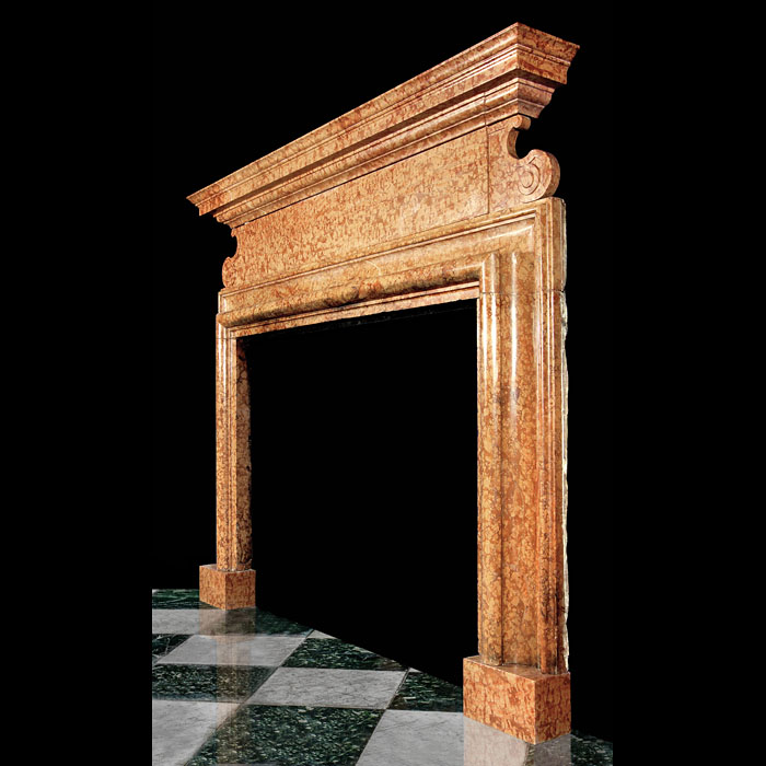An Italian Palazzo style red Verona marble fireplace, one of a near pair