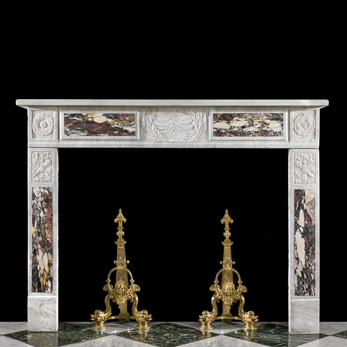 7602: A delicately carved and pretty fireplace in the Italian Imperio manner in Carrara marble, the central plaque with fringed banners and crown of laurels with trophy capitals, all signifying victory, Bre