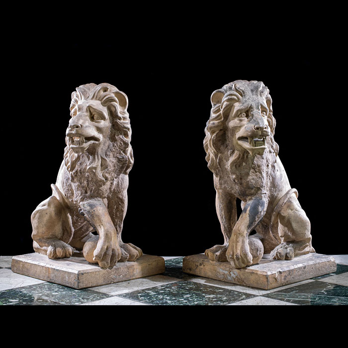 A pair of antique Baroque style terracotta lions
