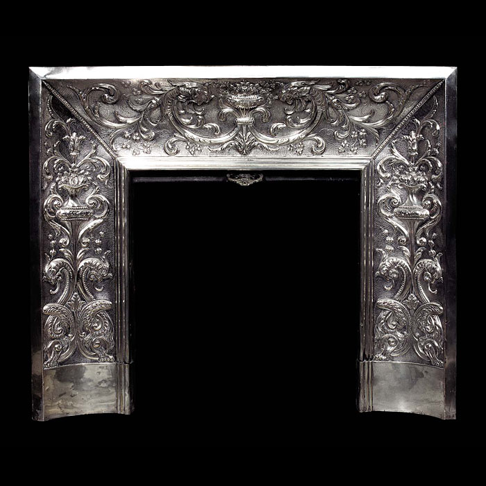 A fine embossed silver-plated Antique Baroque style Fireplace Insert
