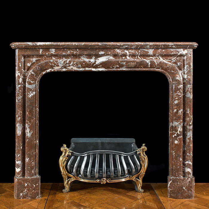 7695: A small French Regence Louis XIV fireplace surround in Rouge Royale marble. French,19th century.  Link to: Antique English Regency chimneypieces inc. Louis XVI, French Empire and George IV fireplace m