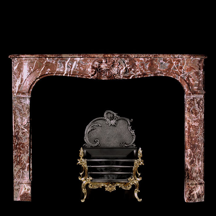 7722: A small Louis XV style mantle, carved in Languedoc marble, with a serpentine shelf & frieze, central shell cartouche and panelled jambs. French 19th century.     Link to: Antique Rococo Chimneypieces