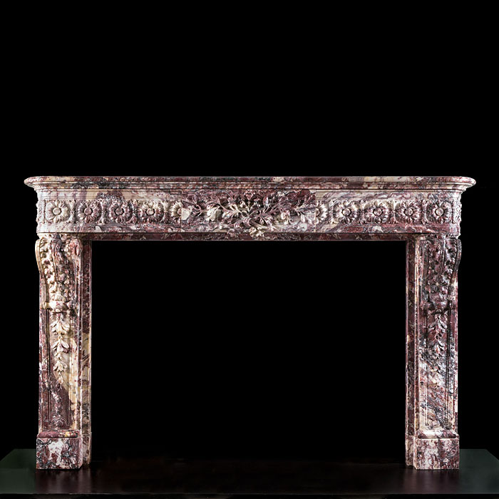7740: 'PETIT TRIANON CHEMINEE SALON COMPAGNIE' :A superbly carved Louis XVI antique fireplace in Fleur de Pecher ( peach flower ) marble with a delicately carved high relief floral centre plaque, high relie