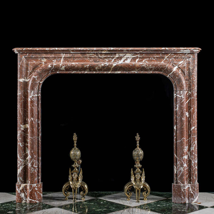 A large Baroque style antique fireplace mantel in Languedoc Marble