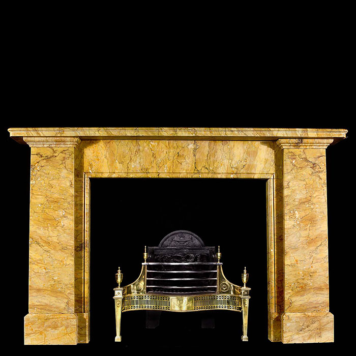 An antique Egyptian Revival Sienna Marble fireplace surround.