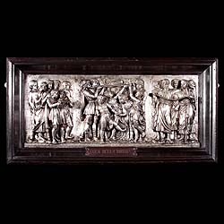An antique silver plated brass plaque of depicting a Florentine youth
