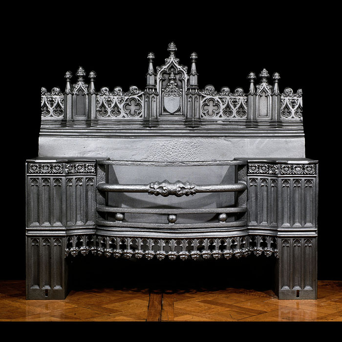 8014: A very large and wide Gothic Revival Hob Grate in the manner of A.W.N. Pugin with a highly ornate castellated backplate. The columned face panels either side of the three barred grate are linked by a