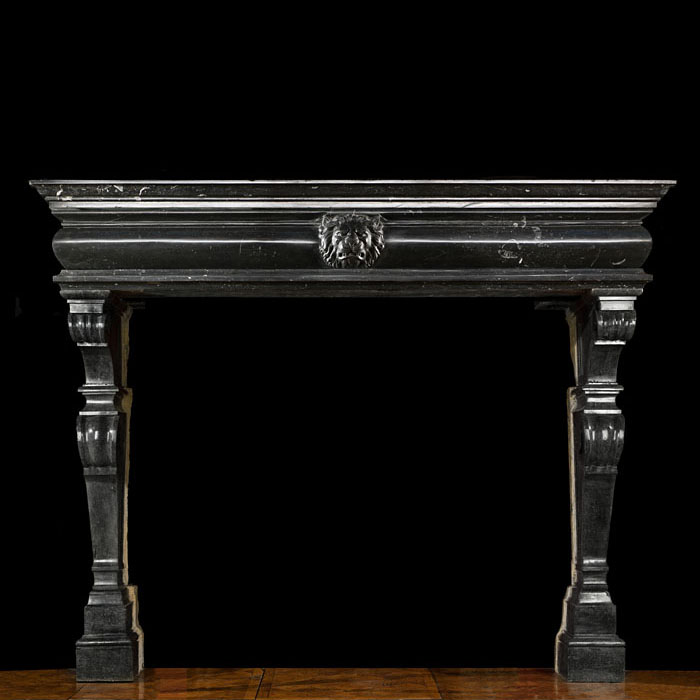An antique Baroque fossil stone fireplace surround