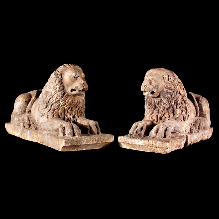 An antique pair of Italian carved stone lions