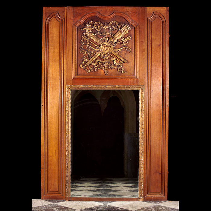 A Louis XVI oak overmantel mirror