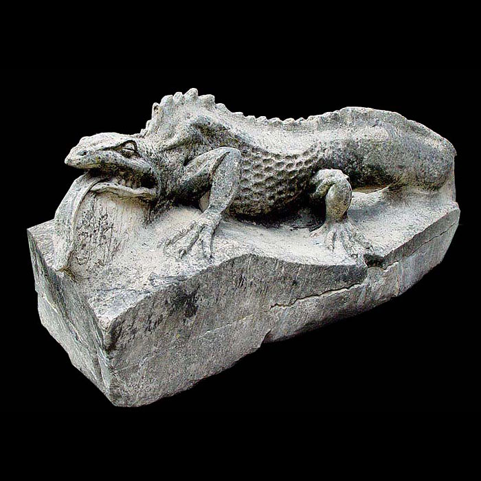 8119: A composition stone figure of a salamander, lying in the sun on a rock.20th century.Image before restoration inc in price.  Link to: Antique fountains, sculptures, garden furniture and statuary