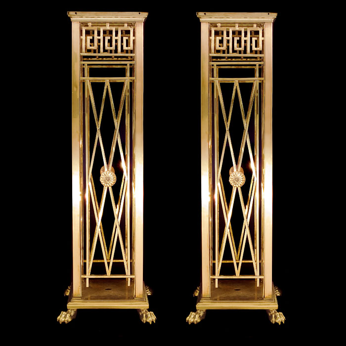 An antique pair of bronze Regency pedestals
