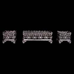8209: A garniture of three cast iron jardineres in the Baroque manner, one large and a smaller pair with scrolled floral oak leaf and bell flower decoration, with liners. French 19th century.