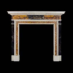 8233: An attractive sophisticated Neoclassical Specimen Marble Chimneypiece of compact size, in the manner of Sir Henry Cheere (1703-1781). The stepped statuary marble shelf over a dentil undershelf support