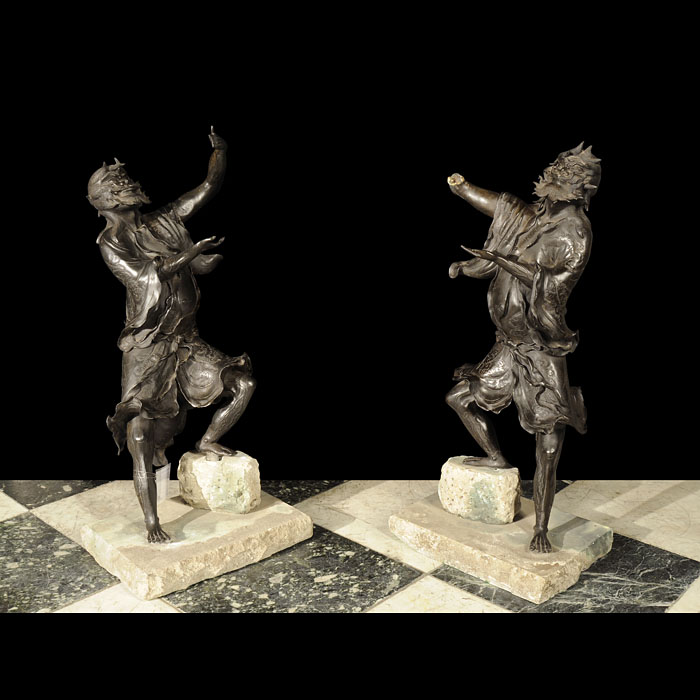 A pair of antique spelter Japanese street entertainers