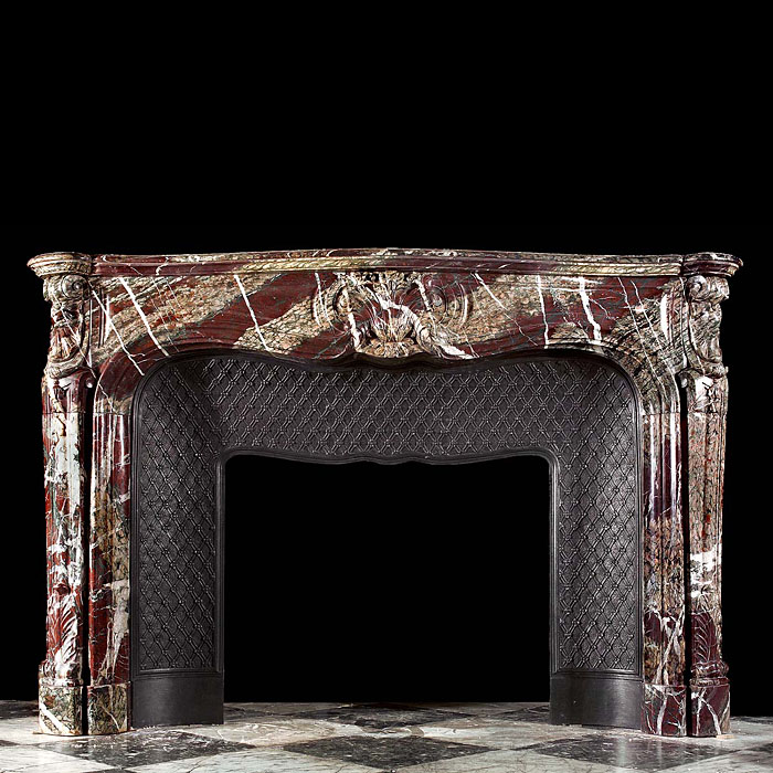 An antique Campan Marble French Rococo fireplace mantel