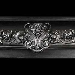 A Victorian cast iron French Regency style Fireplace Mantel