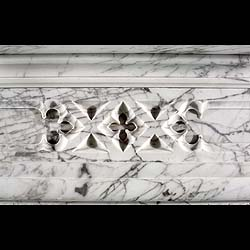 A Victorian Gothic Revival antique marble chimneypiece