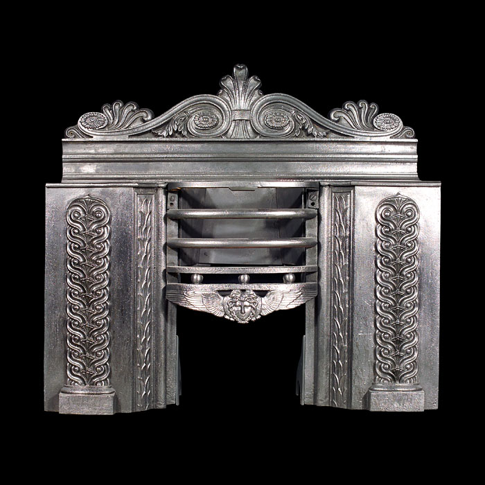8397: A finely decorated hob grate with scrolled floral back plate in the Greek Revival manner, guilloched panels and a winged angel on the fire bar apron.Early 19th century  Link to: Antique Hobgrates
