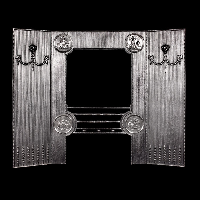 A Triple Panel Cast Iron Fireplace Insert