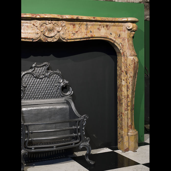 A fine Antique Breche d'Allepe marble Louis XV chimneypiece