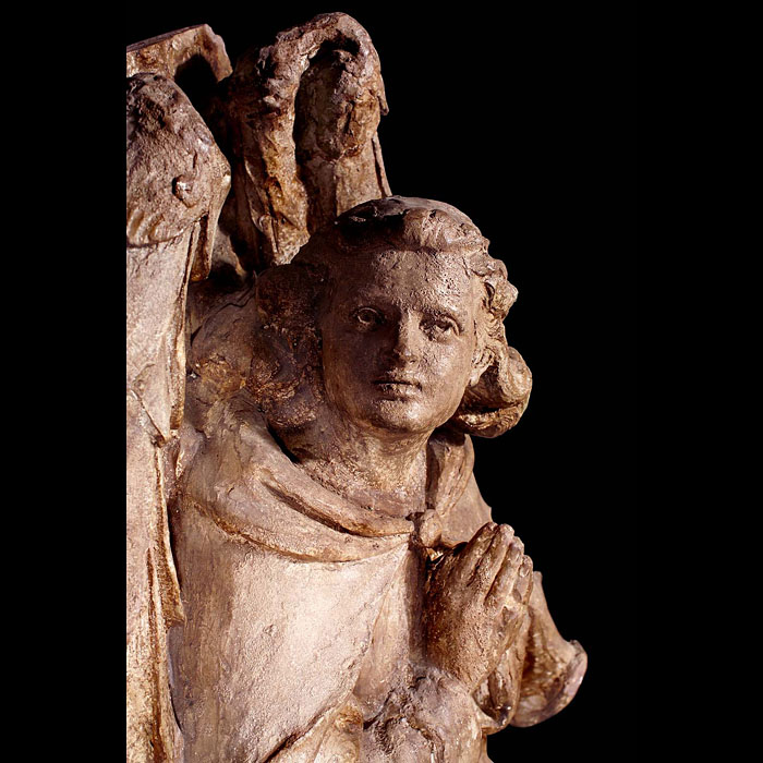 A pair of late 18th century plaster sculptures of angels at prayer.
