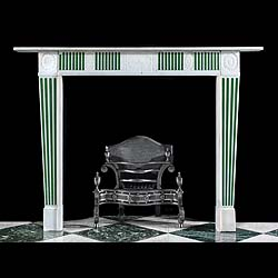8458: A small 20th century English Regency style chimneypiece in Statuary Marble with light green Scagliola inlaid flutes on the frieze panels and the tapering jambs, the central panel is decorated with a f
