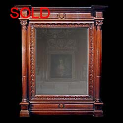 A large Palladian style carved oak overmantel