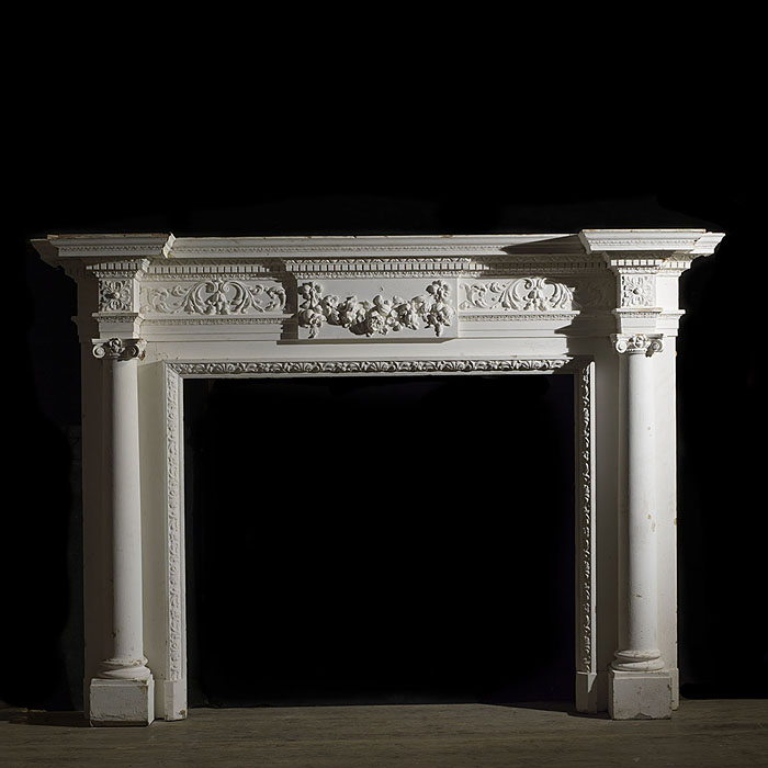 8512: A large and grand painted pine & gesso Adam style Georgian fireplace surround. The breakfront shelf over a foliate decorated central tablet and frieze, supported on tapered columns with Ionic capitals