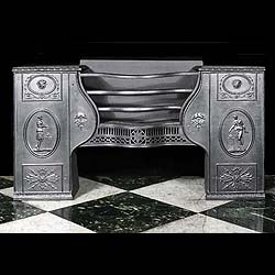 8551: A large cast iron Hob Grate in the style of Robert Adam made by the Carron Foundry, Falkirk, Scotland. The Romanesque style decoration depicts Maidens tending incense burners with Mercurial masks & wi