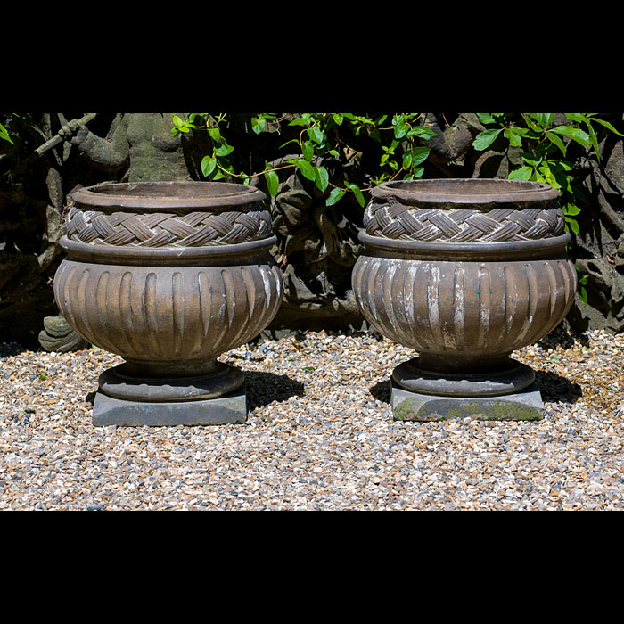 8638: A large pair of Terracotta Urns in the Baroque manner with fluted and basket weave effect around the necks. English 1930's.  Link to: Antique fountains, sculptures, garden furniture and statuary