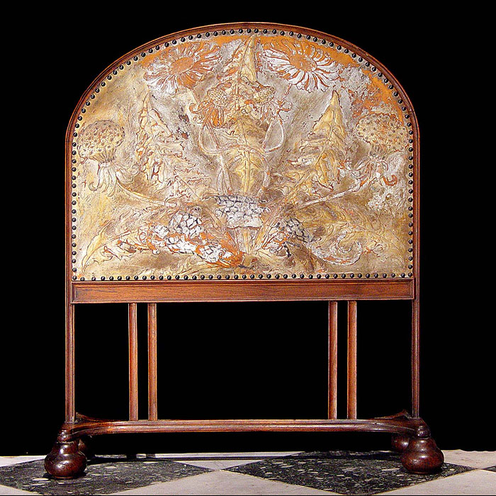 8686: An Arts & Crafts walnut & embossed leather firescreen in the manner of George Jack of Morris & Company, the screen depicting mythical dragons among foliage and thistles.Early 20th century   Link to: