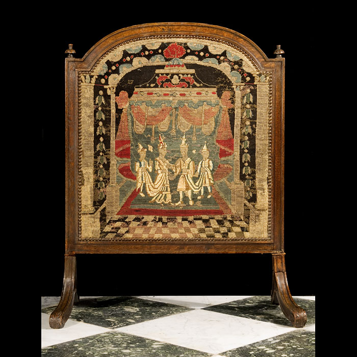 8687: An oak framed firescreen in the Baroque manner. The 18th century tapestry panel depicts Eastern Royal Couple attended by two Pages, with a marquee in the background. Photo before restoration. English,