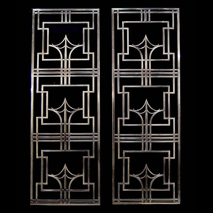 A pair of stainless steel Art Deco grills