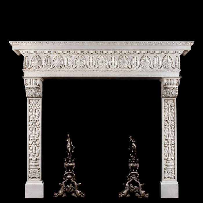 8864: A very grand Italian Renaissance style antique fireplace mantel in white Statuary marble. The stepped shelf, edged with richly carved lambs tongue detail over an egg and dart border, sits above a very