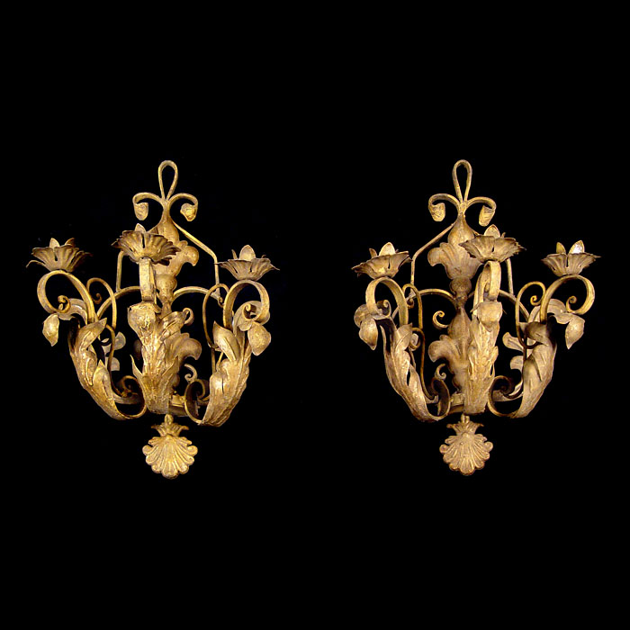 A 20th century pair of repousse metal wall lights
