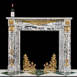 A small Louis XVI Breche Violette marble fireplace mantel